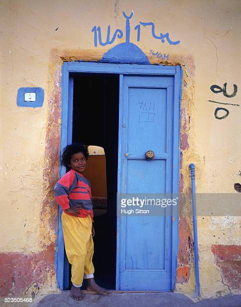 girl standing in doorway, egypt - hugh sitton stock pictures, royalty-free photos & images