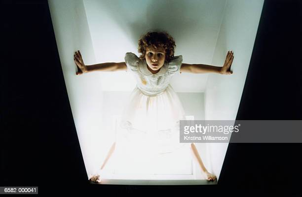 Girl Standing in Dormer Window