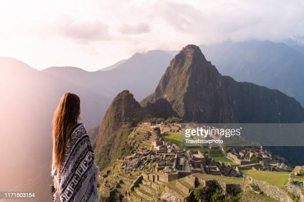 girl standing in front of machu picchu peru, south america - travel stock pictures, royalty-free photos & images