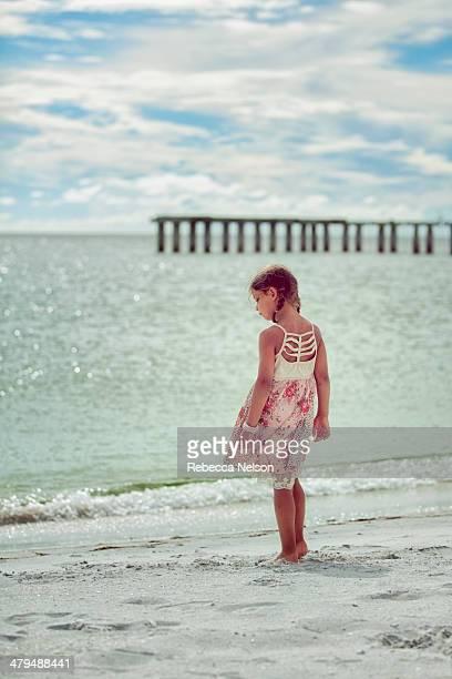 girl standing in front of ocean
