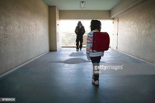 girl standing in front of prowler - stalker person stock photos and pictures