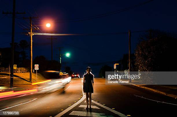 Girl standing in middle of road