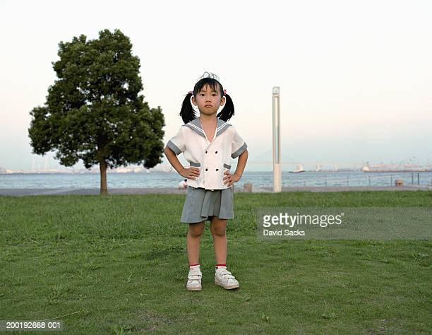 girl (3-5) standing in park with hands on hips, portrait - sadgirl stock pictures, royalty-free photos & images
