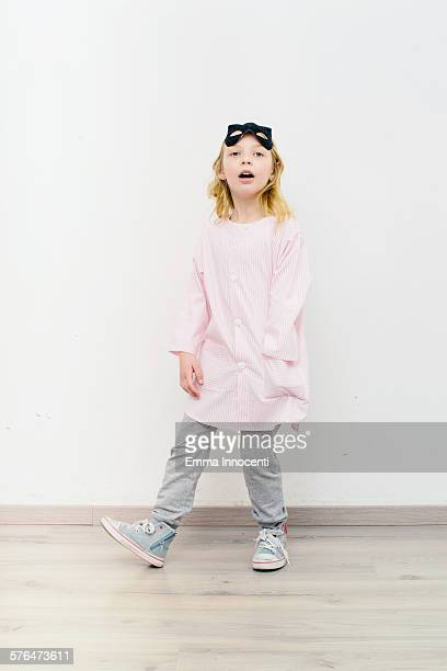 girl standing in school apron with cat mask