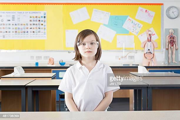 girl (11-13) standing in school laboratory