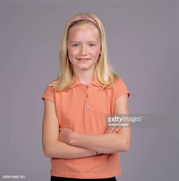 Girl (12-13) standing in studio, portrait