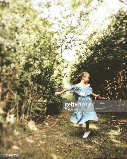 girl standing in the forest dancing, united kingdom - long dress stock pictures, royalty-free photos & images
