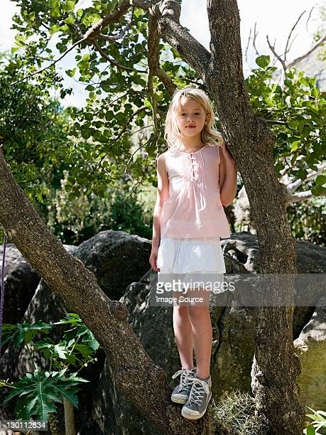 Girl standing in tree, portrait