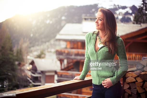 Girl Standing on Balcony In the Swiss Alps