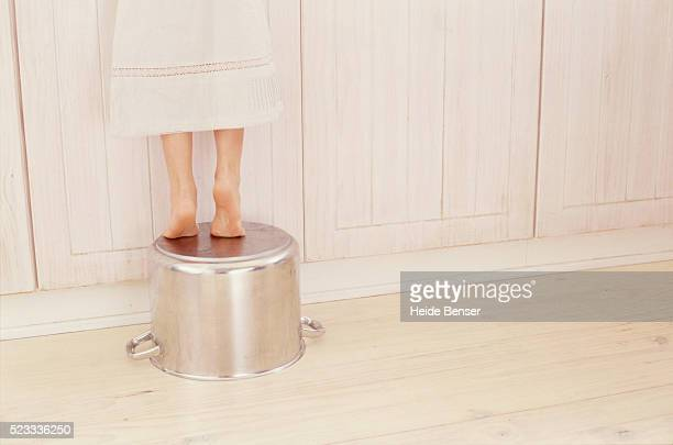 Girl Standing on Cooking Pot