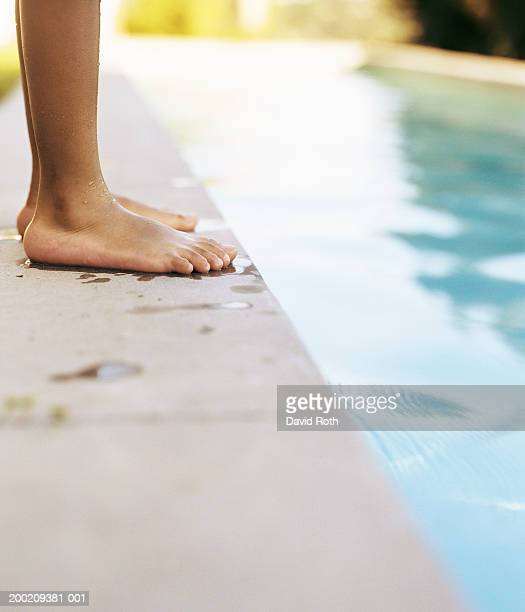 Girl standing on edge of pool (low section)