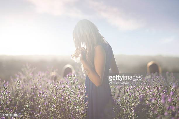 Girl standing on meadow