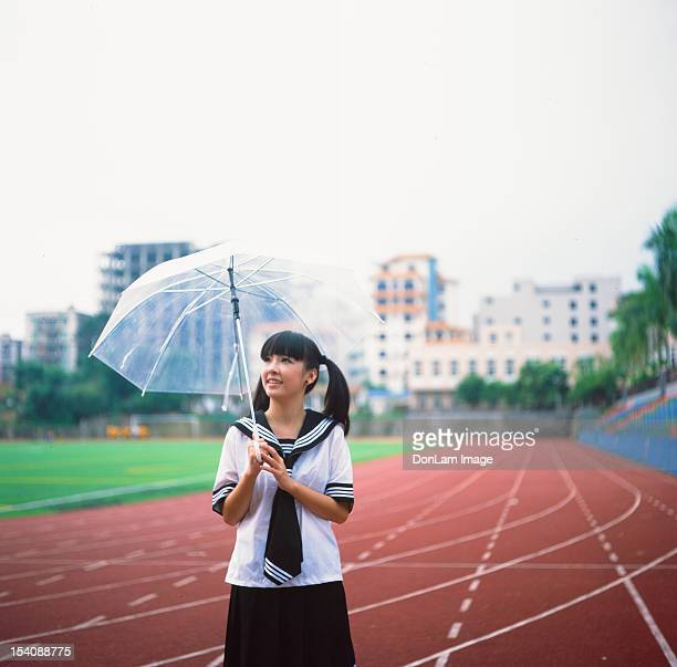 girl standing on racing track - zhanjiang stock photos and pictures