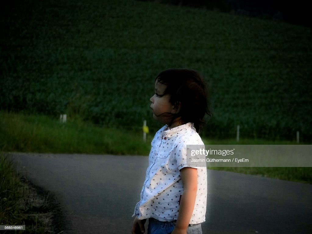 Girl Standing On Road At Morning : Stock Photo