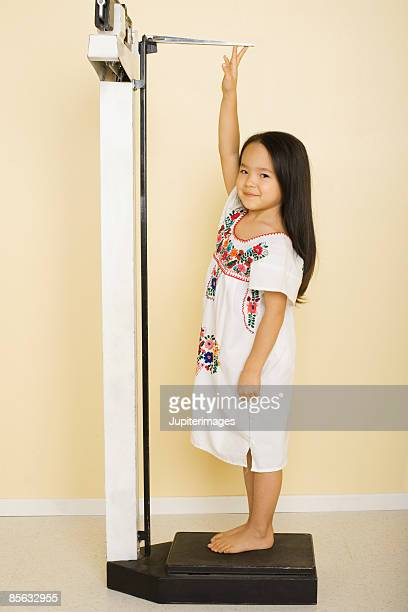 Girl standing on scale