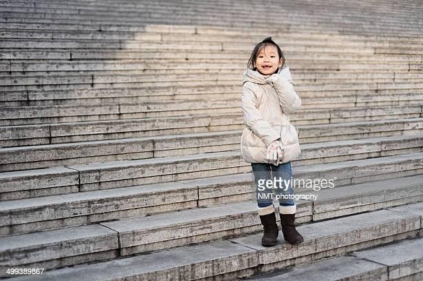 Girl standing on steps