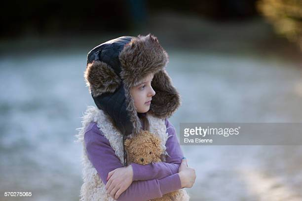 Girl standing outdoors on a frosty morning