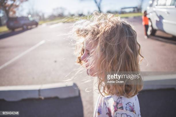 Girl standing outside in Parking lot