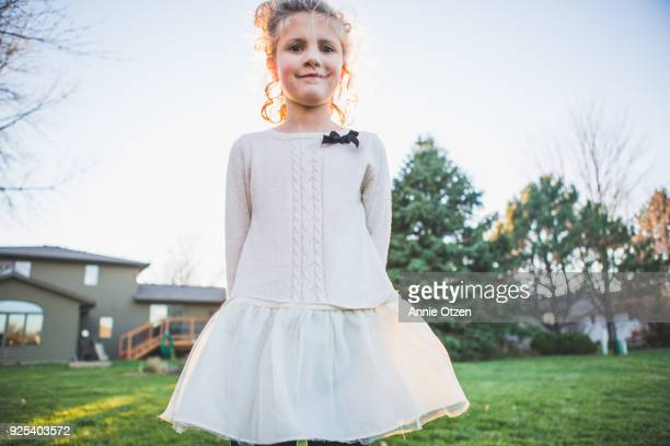 Girl Standing Proudly Outside