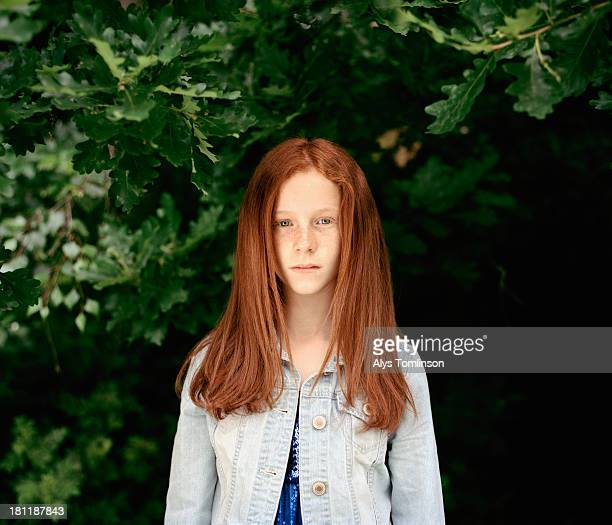 girl standing under a tree - 13 year old black girl stock photos and pictures