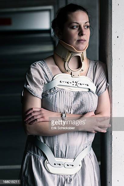 girl standing with a back- and a neckbrace