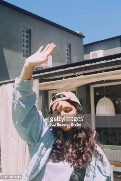 Girl Standing With Arms Raised Standing Outdoors