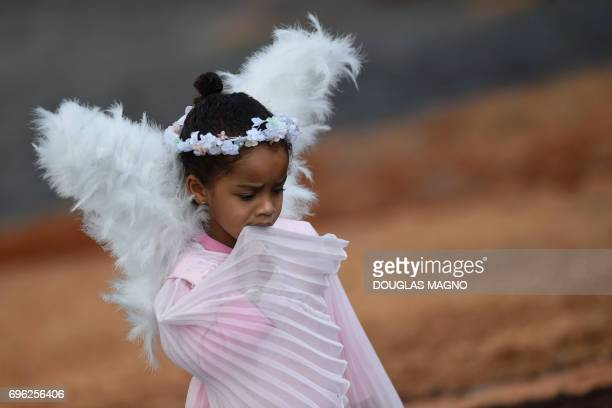 Girl stands amid sawdust carpets during the Catholic Corpus Christi celebration in a street of Ouro Preto, some 100 km from Belo Horizonte, Brazil,...