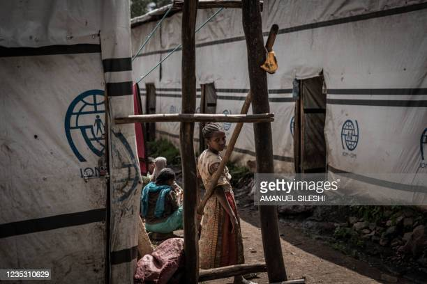 Girl stands at a camp for internally displaced people who fled the war from May Tsemri, Shire and Addi Arkay in Dabat, 70 kilometres Northeast of the...