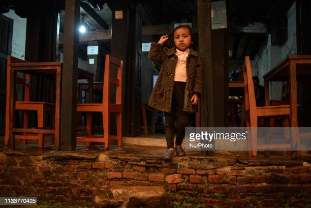 A girl stands at the entrance to the restaurant in Bandipur Nepal on March 30 2019