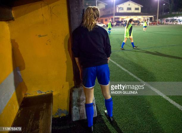 A girl stands close to the bench during a training session at the Anorga KKE football school in the Spanish Basque city of San Sebastian on February...