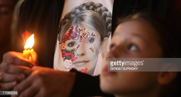 A girl stands in front of a portrait of Ukrainian's opposition leader Yulia Tymoshenko depicted on a tshirt during a mass prayer service on Sofia...