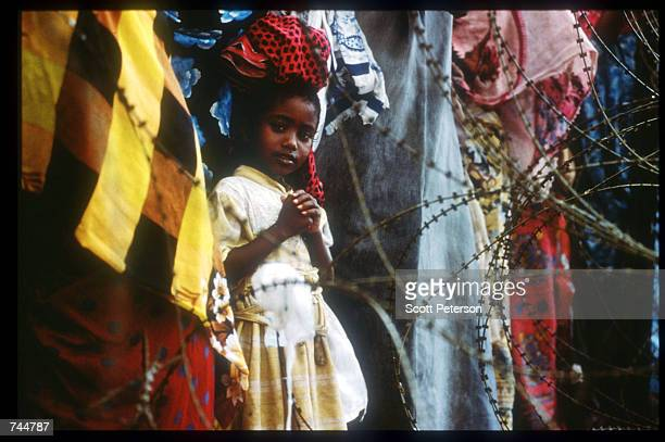 A girl stands in line at a food distribution site June 20 1993 in Mogadishu Somalia An estimated 350000 Somalis died due to war famine and disease...
