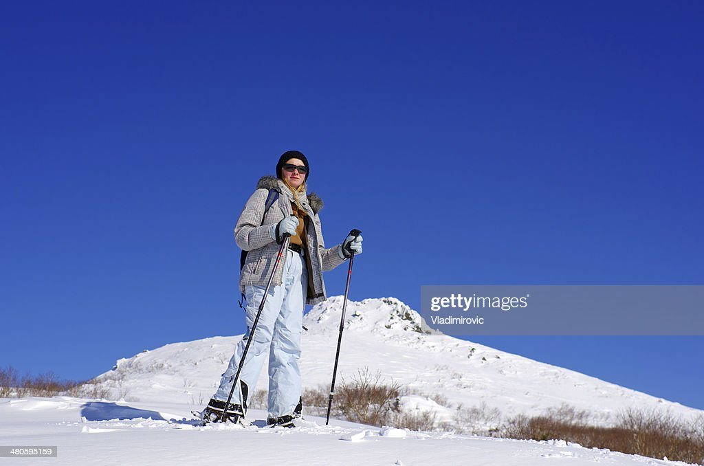 Girl stands on snow top : Stock Photo