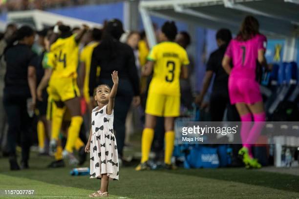 A girl stands on the pitch after the 2019 FIFA Women's World Cup France group C match between Jamaica and Australia at Stade des Alpes on June 18...