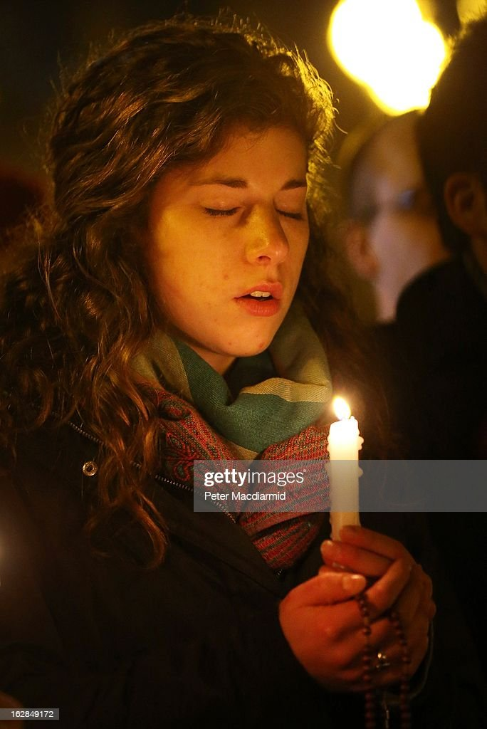 A girl stands with a candle in St Peter's Square as prayers are said for Pope Benedict XVI in the moments before he ceased to be Pontiff at 20:00 CET on February 28, 2013 in Vatican City, Vatican. Pope Benedict XVI has been the leader of the Catholic Church for eight years and is the first Pope to retire since 1415. He will stay at the Papal Summer residence of Castel Gandolfo until renovations are complete at a monastery in the grounds of the Vatican, and will be known as Roman pontiff emeritus or pope emeritus.