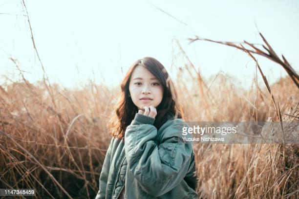 girl staring at here - yusuke nishizawa stock-fotos und bilder