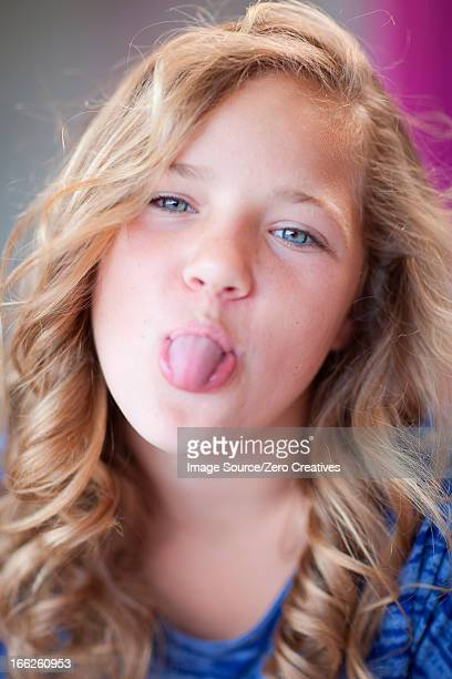 girl sticking her tongue out - little girl sticking out tongue stock photos and pictures