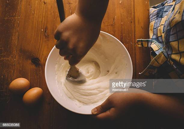 girl stirring batter for cake - mixing stock pictures, royalty-free photos & images