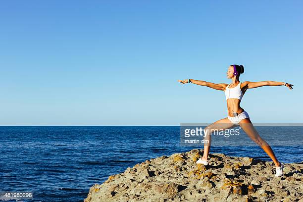 Girl stretching at the beach