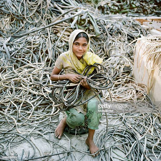 girl striping copper from wires - day labor in bangladesh stock photos and pictures