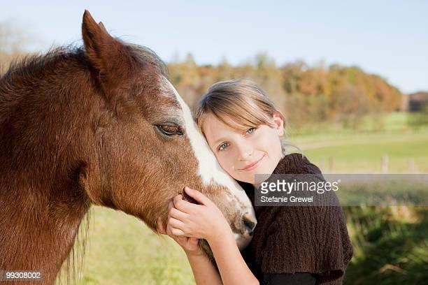 girl stroking a horse - stefanie grewel stock-fotos und bilder