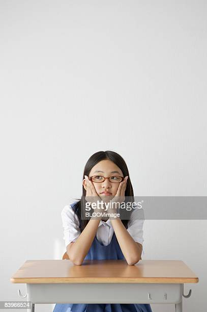 Girl student wearing glasses, thinking