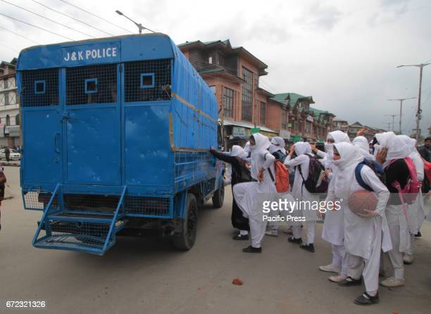 Girl students attack police vehicles during clashes Many students sustained injuries after Indian police used teargas shells chili smoke water...