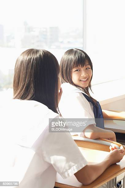 Girl students chatting in classroom