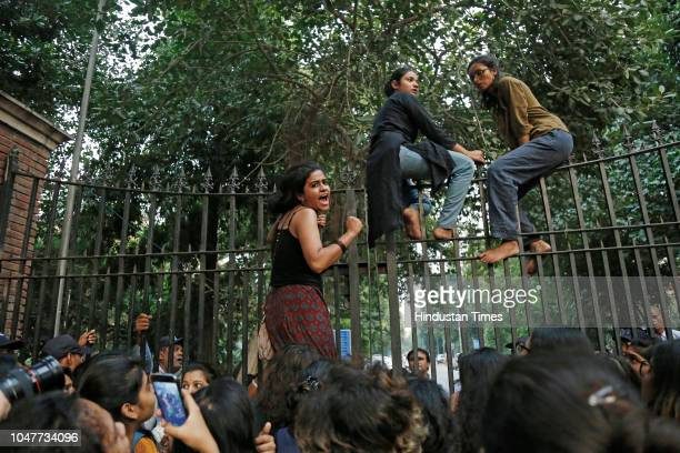 Girl students of Delhi University and members of Pinjratod protest for their demands regarding to equal rules for men and women in Indian...