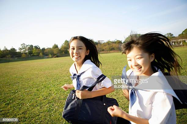 Girl students running in the park