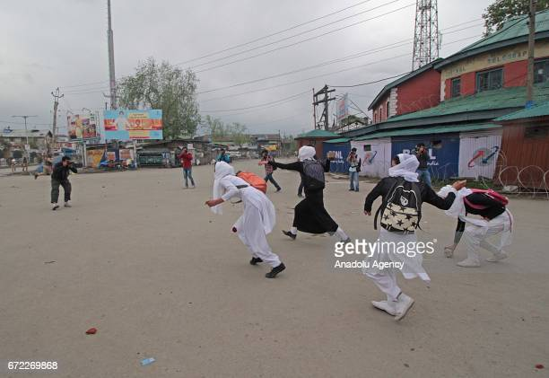 Girl students throw stones at Indian police during clashes in Srinagar the summer capital of Indian controlled Kashmir on April 24 2017 Many students...