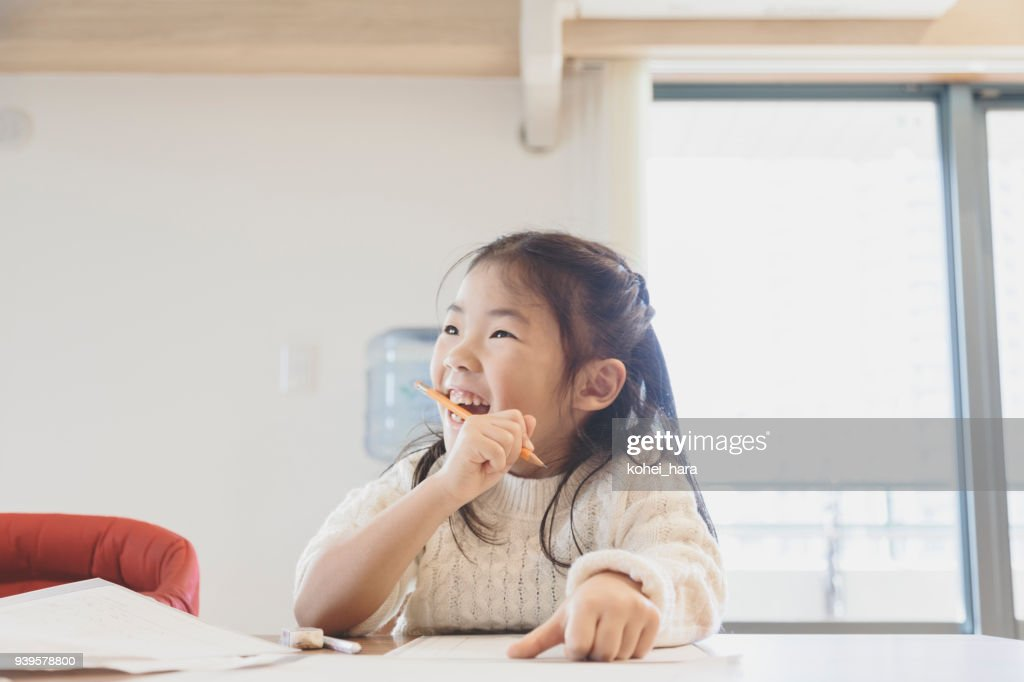 Girl studying at home : Stock Photo