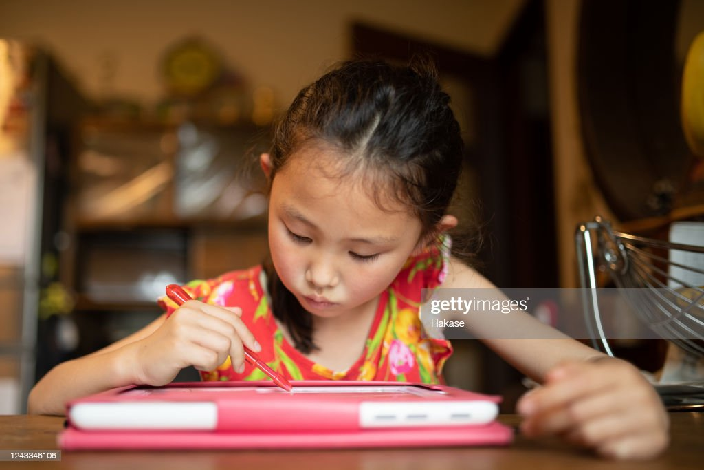 Girl studying on tablet device : Stock Photo