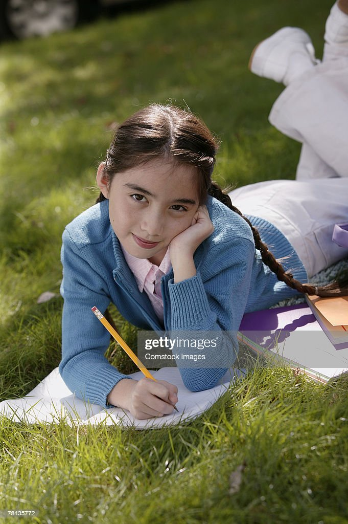 Girl studying outdoor : Stock Photo